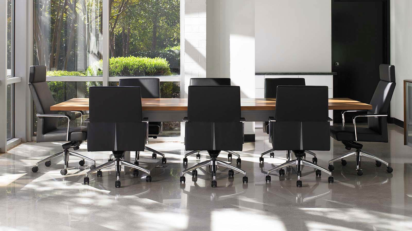 Black corporate chairs inside a meeting room